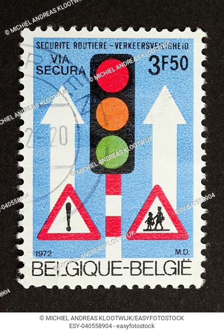 BELGIUM - CIRCA 1970: Stamp printed in Belgium shows a traffic signs and a traffic light, circa 1970