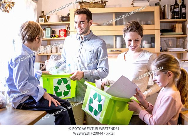 Family at home with waste boxes