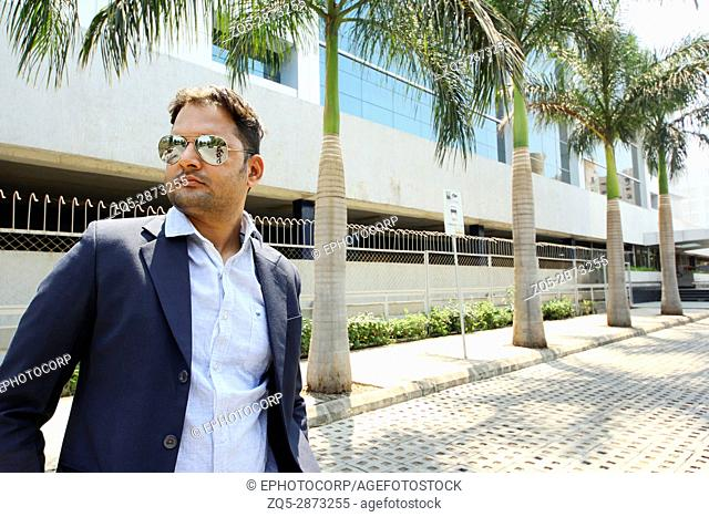 Young Indian corporate business man with goggles