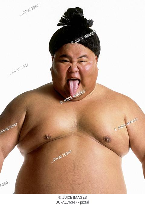 Portrait of a sumo wrestler sticking his tongue out