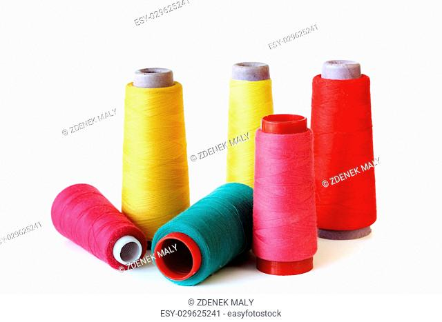 colored thread to sew on white background