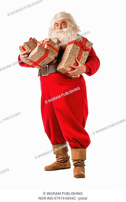 Santa Claus with gift boxes isolated on white background. Full length portrait