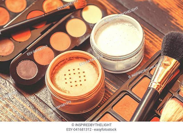 Professional visagiste workspace. Makeup tools. Creative mess