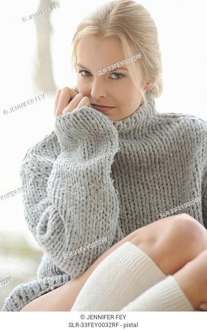 Woman wearing thick sweater and socks