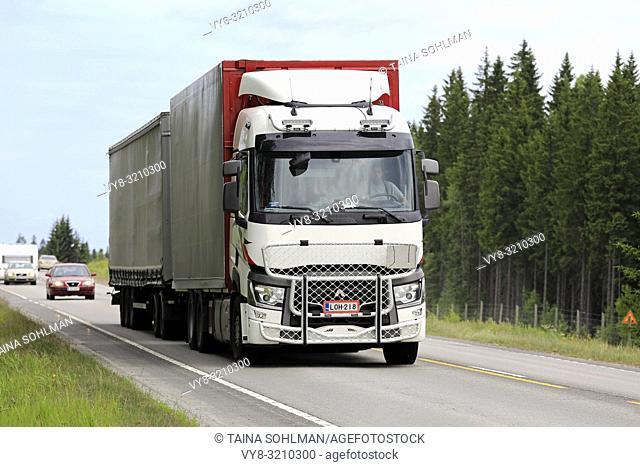 Hirvaskangas, Finland - June 15, 2018: White Renault Trucks T cargo transporter with bull bar of Kuljetus Aarne Vaananen Oy at speed among traffic on highway 4...