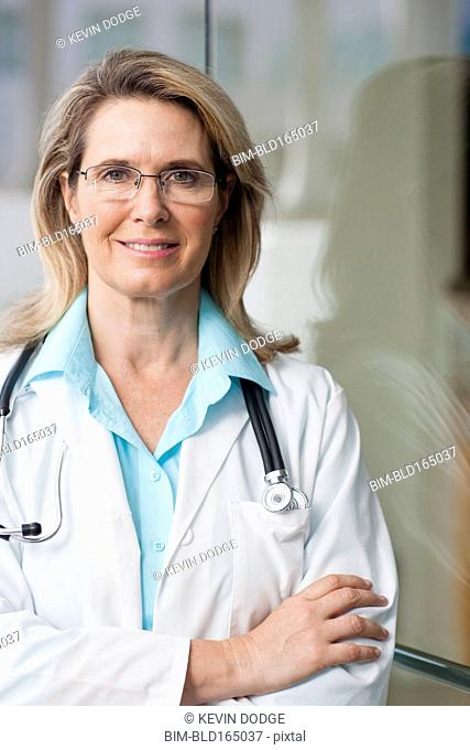 Caucasian doctor smiling with arms crossed