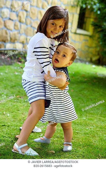 Sisters playing in the park. Girls. Getaria. Gipuzkoa. Basque Country. Spain