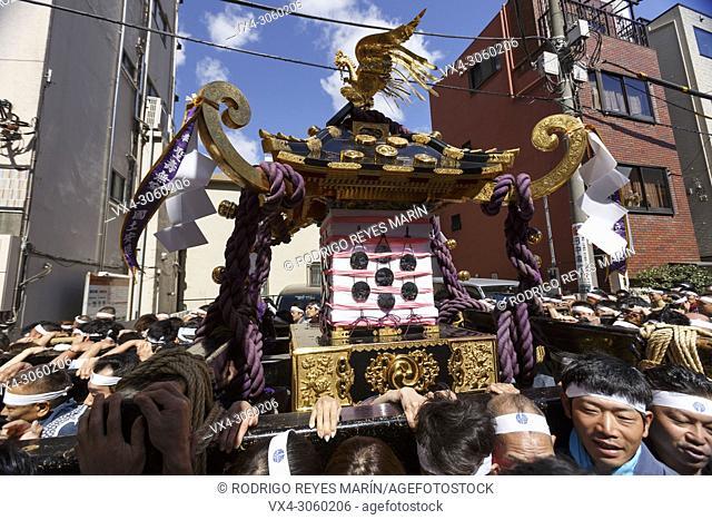 Participants carry a Mikoshi (portable shrine) during the Sanja Matsuri in Asakusa district on May 20, 2018, Tokyo, Japan