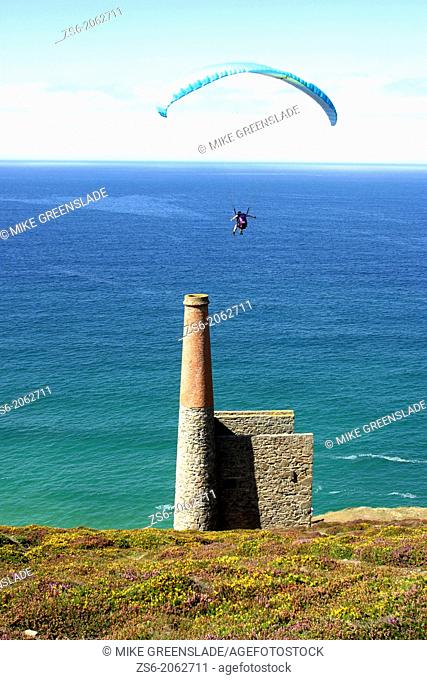 Paraglider above Towanroath engine house, Wheal Coates, St Agnes, Cornwall, UK