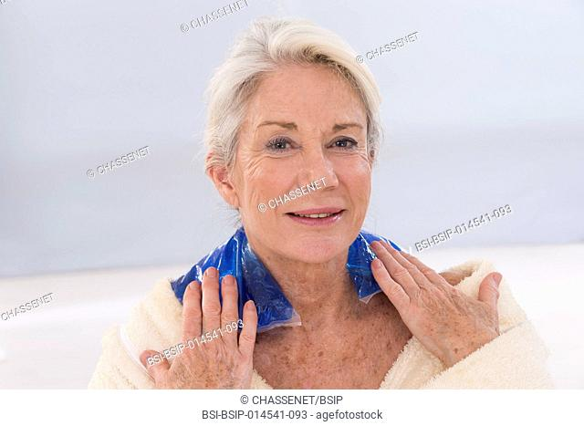 Senior woman using cold/hot pack