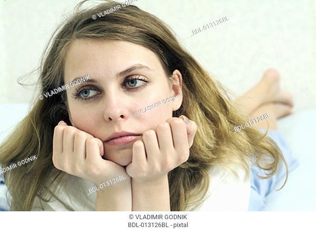 portrait of bored looking teenage girl