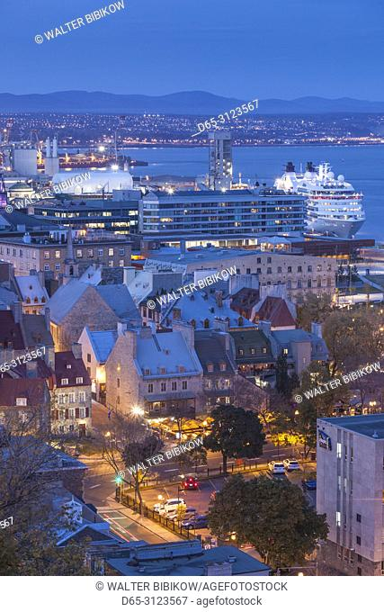 Canada, Quebec, Quebec City, elevated view of the Old Lower Town and cruiseship, evening