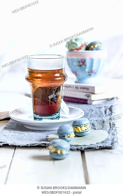 Black tea, french macarons and books