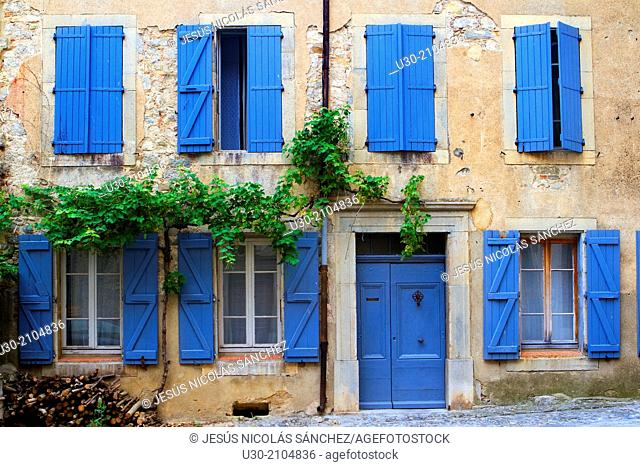 Typical street in Lagrasse town, french village listed as one of the Most Beautiful Villages of France. In the Aude department, and Languedoc-Roussillon region