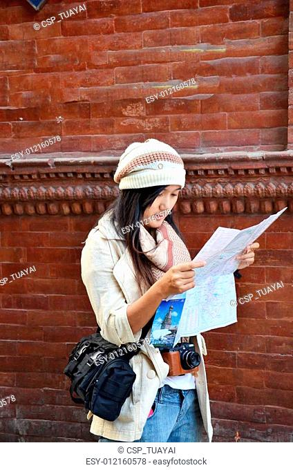 Traveler Thai woman with map
