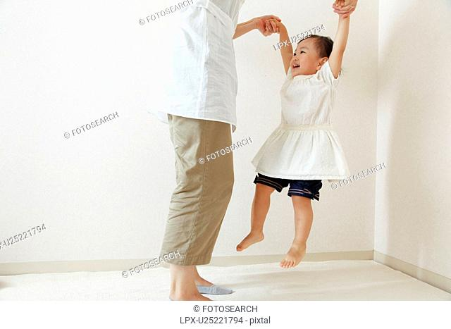 Girl playing with mom