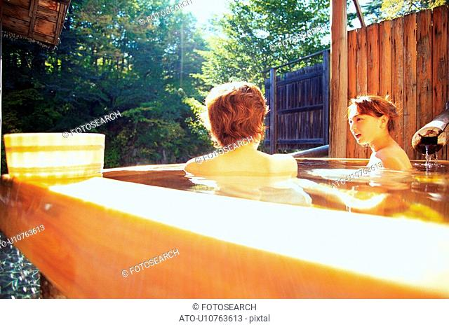 Two Young Adult Women Taking a Bath