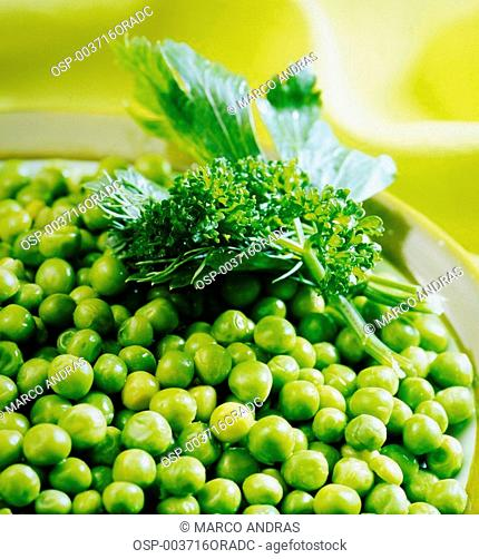 a served plate with raw peas