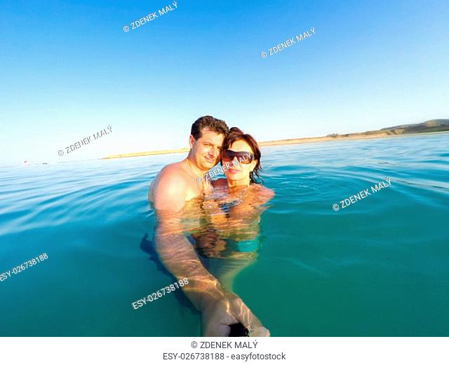 Couple having fun in the water summertime holidays