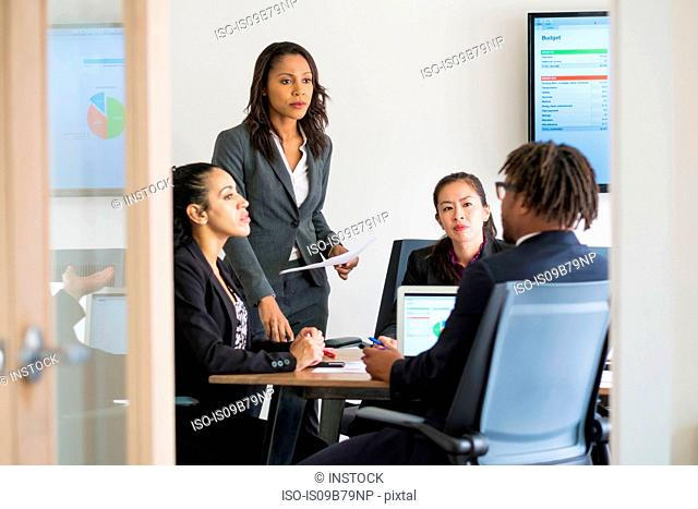 Businessman and businesswomen sitting in office, having discussion