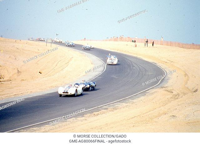 Action view of sports car driving at speed during the SCCA National Races in Bridgehampton, New York, August 17, 1958. In the lead car is Mr