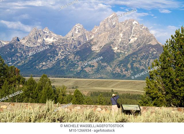 Photographer taking a photo of the Grand Tetons