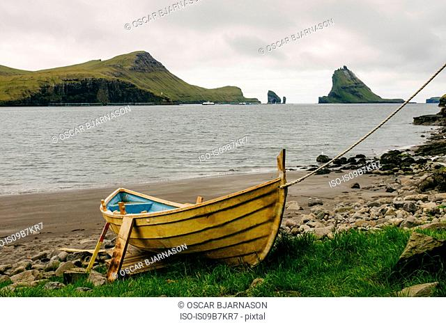 Boat on shore, Tindholmur in the background, Bour, Faroe Islands, Denmark