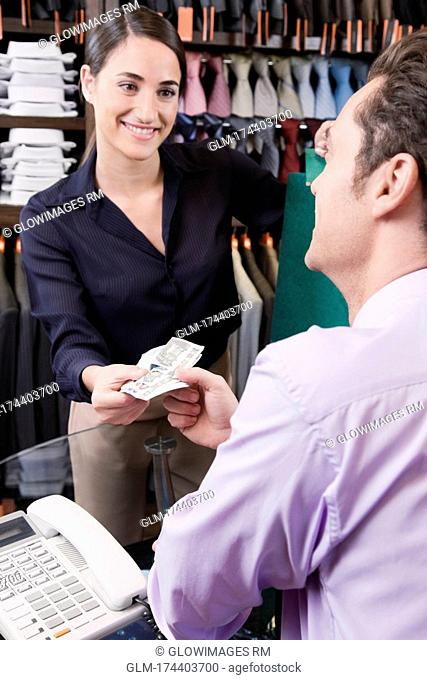 Man paying to a sales clerk in a clothing store