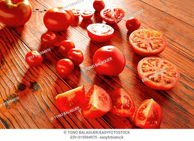 Tomatoes in a red monochrome rustic wooden table