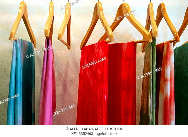 hangers, atelier of natural textiles, Ikaten shop, Gracia District, Barcelona, Catalonia, Spain