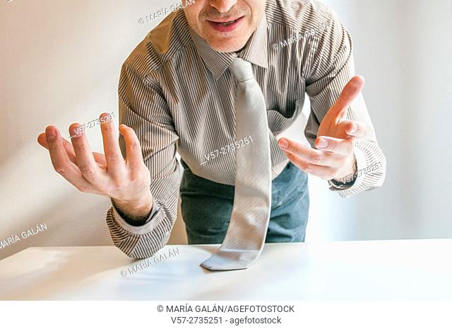 Businessman speaking standing by the table