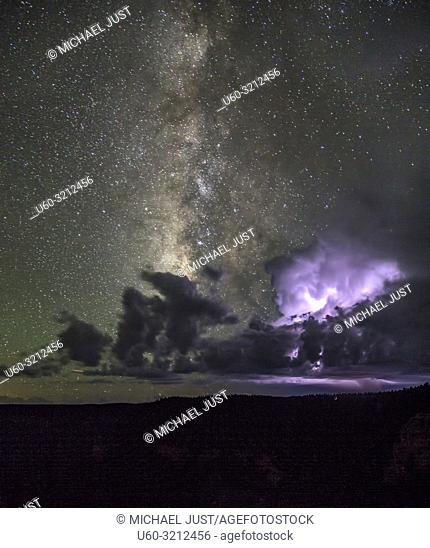 The Milky Way appears during a thunderstorm at The Grand Canyon at Grand Canyon National Park, Arizona