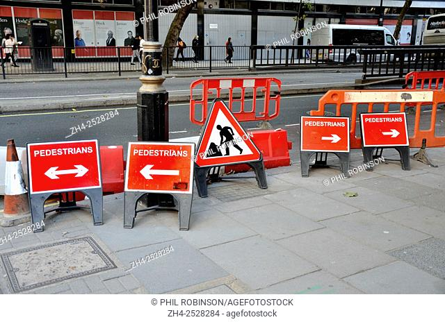 London, England, UK. Confusing / contradictory signs for pedestrians at roadworks