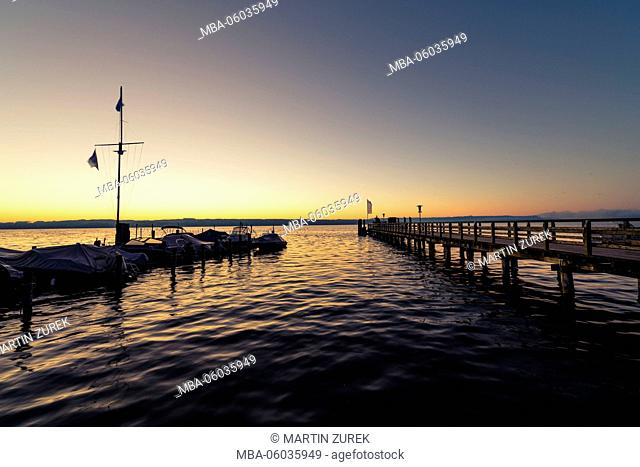 Sunrise in Utting am Ammersee / Lake Ammer, shore, morning, sunlight, lakeside promenade, Germany, Bavaria, Ammersee / Lake Ammer