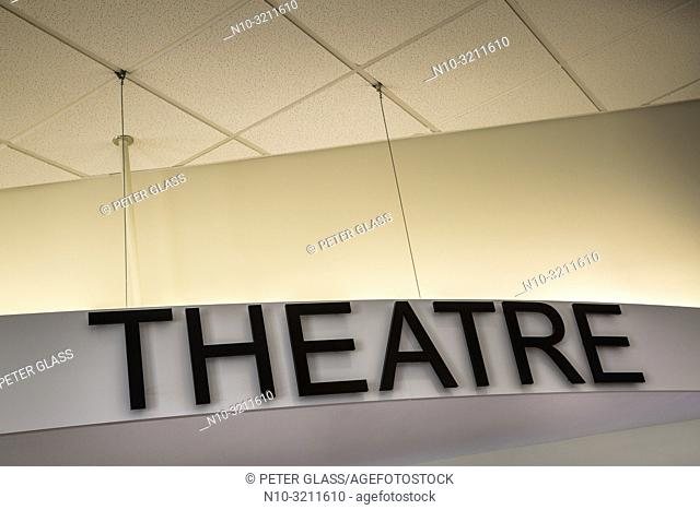 "Close-up of a theater marquee with """"Theatre"""" written on it"