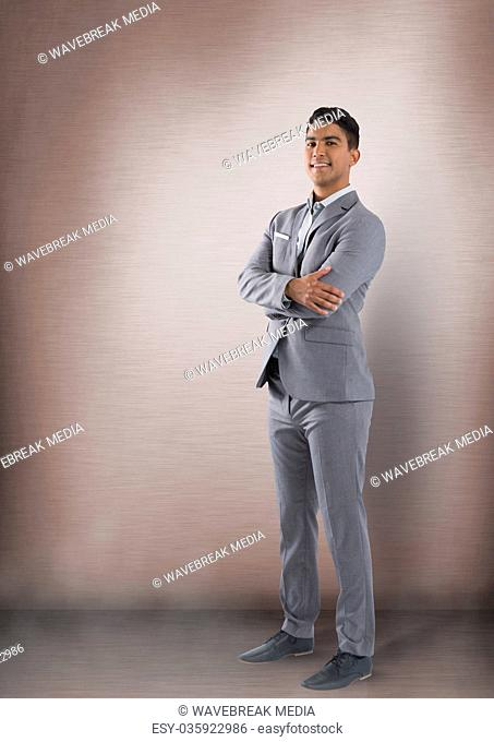 Businessman with arms folded in room