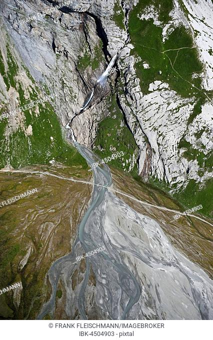 High valley with a river, beneath the mountains Fuorcla Raschaglius and Piz Segnas, near Flims, Canton of Grisons, Switzerland