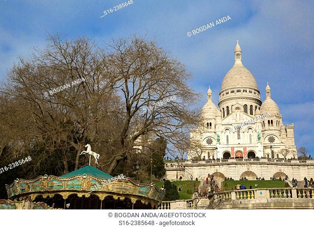Paris, France - Merry Go Round in front of Sacre-Coeur Basilica, in Montmartre