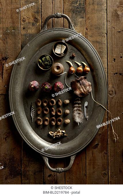 Platter of dried fruit, wood, plants and string