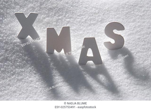 White Wooden Letters Building English Text Xmas. Snow And Snowy Scenery. Christmas Atmosphere. Christmas Background Or Christmas Card For Seasons Greetings