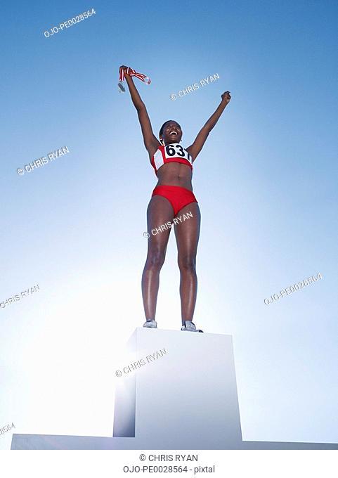 Podium with winning athlete on top