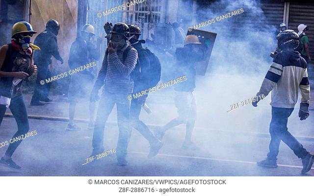 Anti-government protesters clashed with security forces blocking an opposition march to reach the Interior Ministry in Caracas, Venezuela, on Thursday, May 18