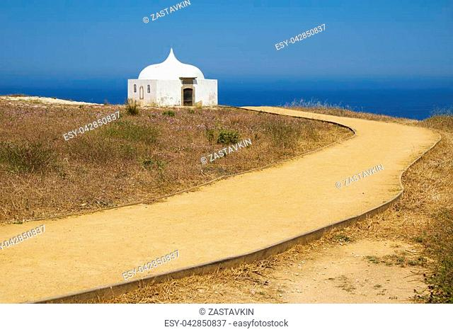 Path near Ermida da Memoria or Memory Chapel of Nossa Senhora do Cabo Church near cape Espichel in Sesimbra, Portugal