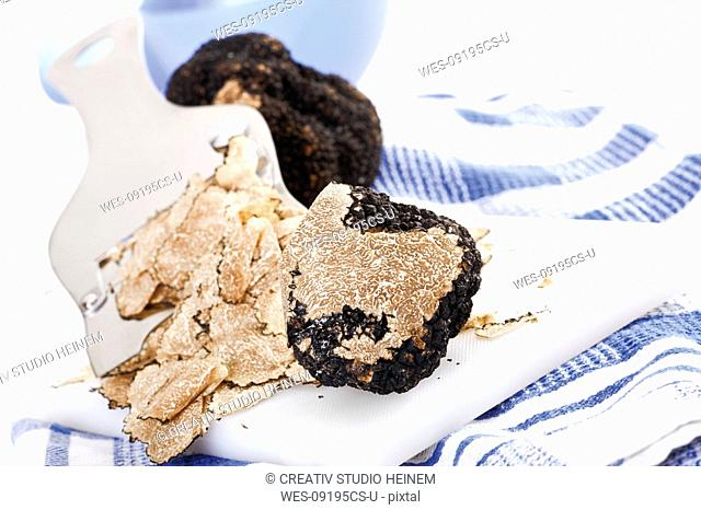 Black Truffles on checkered dish cloth