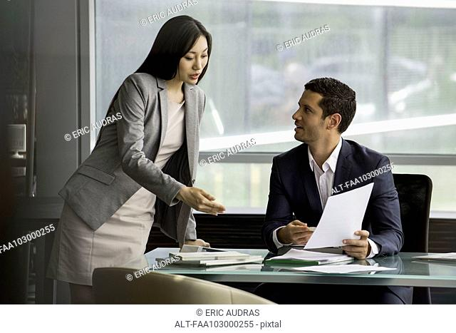 Assistant working with executive