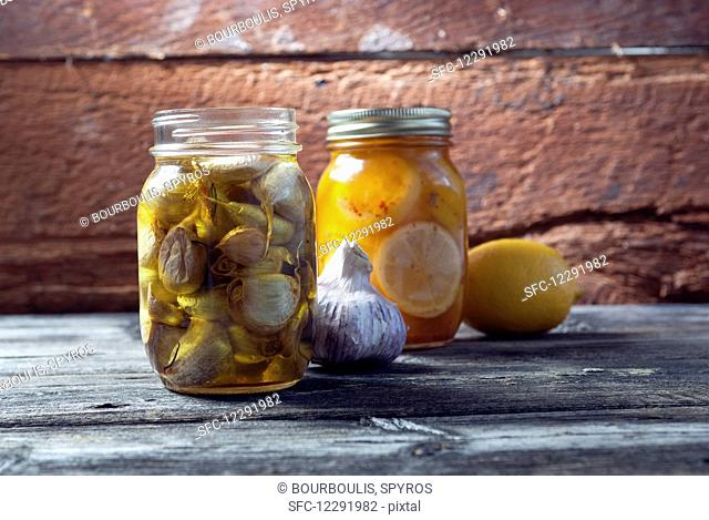 Preserved garlic and lemons in mason jars