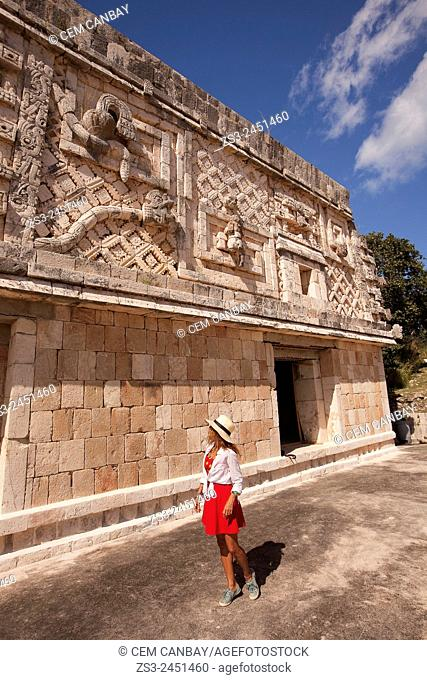 Tourist a the Quadrangle Of The Nuns in Uxmal Ruins, Uxmal, Yucatan Province, Mexico, Central America