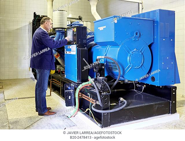 Technician checking cogeneration engine of electric generator, uninterrupted electric service, Hospital Donostia, San Sebastian, Basque Country, Spain