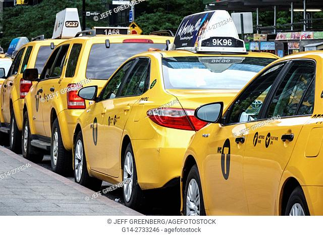 New York, New York City, NYC, Lower Manhattan, Financial District, yellow, taxicab stand, cab, taxi, parked, car, SUV, ad, waiting