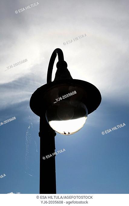 old streetlamp against sky